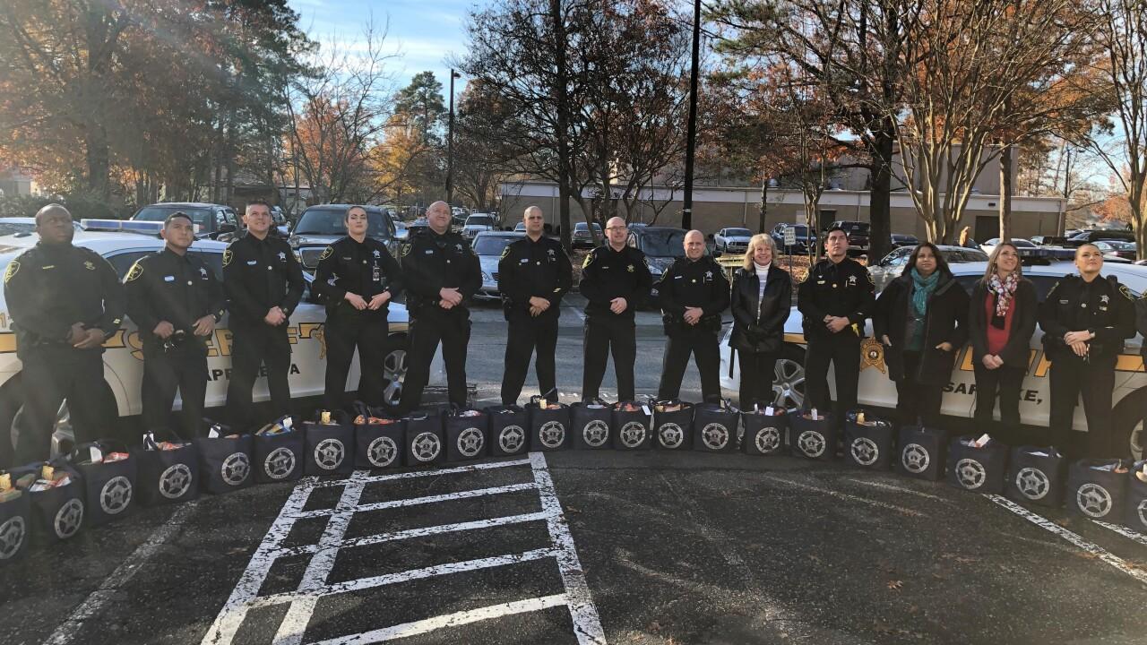 Chesapeake Sheriff's Office deputies deliver food baskets to seniors inneed