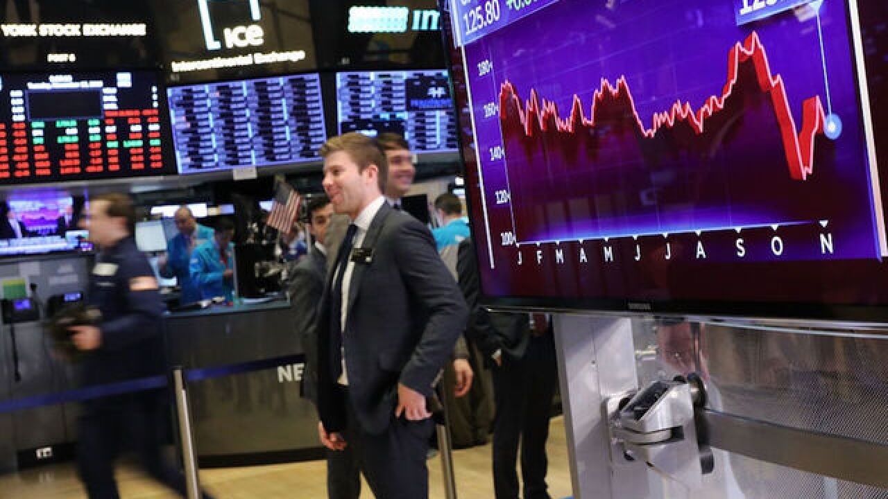 Dow falls 300 points, dragged down by more Apple woes