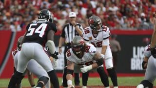 Tampa Bay Buccaneers center Ryan Jensen prepares to snap football to QB Tom Brady vs. Atlanta Falcons, Sept. 19, 2021