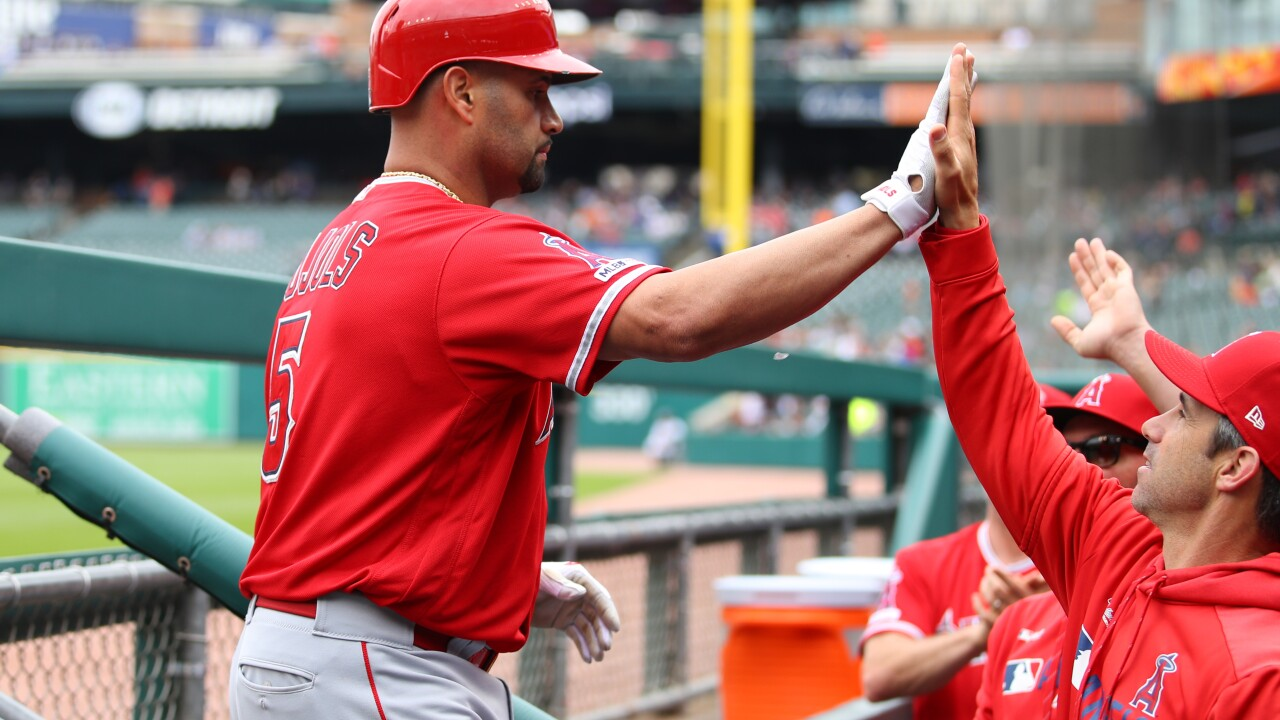 Albert Pujols reaches 2,000 RBIs and Angels rout Tigers