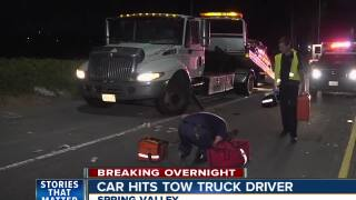 Tow truck driver hospitalized after being hit by car on SR-125