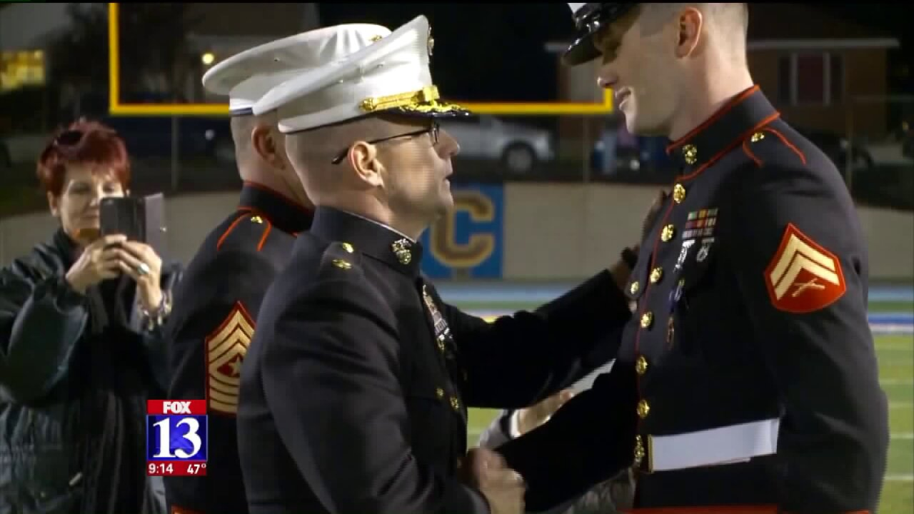 Retired Marine now teaching in Utah receives Purple Heart athalftime