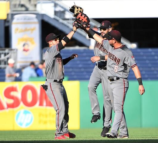 PHOTOS: Diamondbacks outlast Pirates, and rain delay, en route to 14 inning win Wednesday