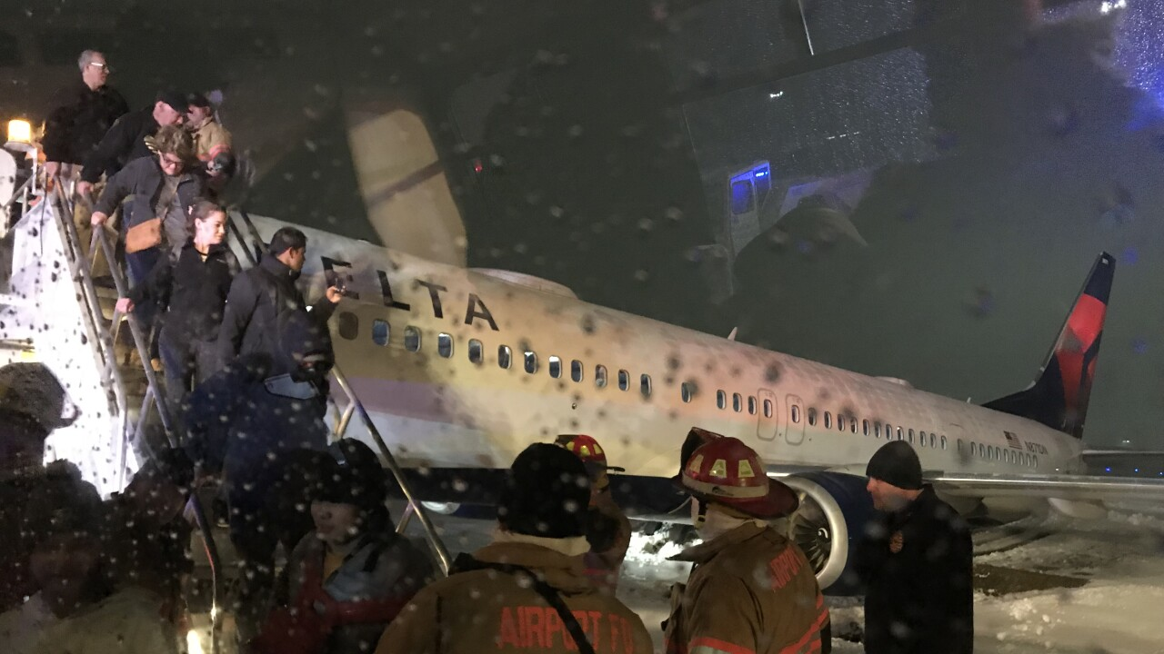 Passengers exit disabled aircraft at CVG
