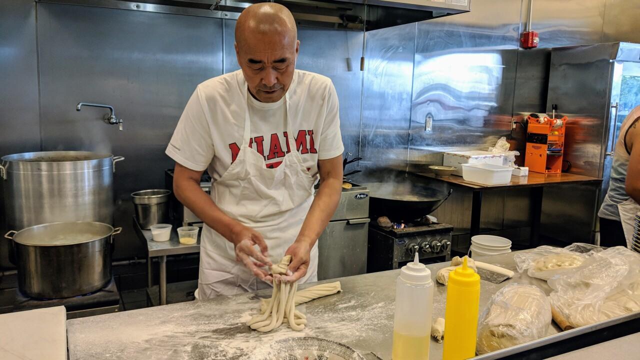 5-Noodle master pulling noodles (photo by G Yek).jpg