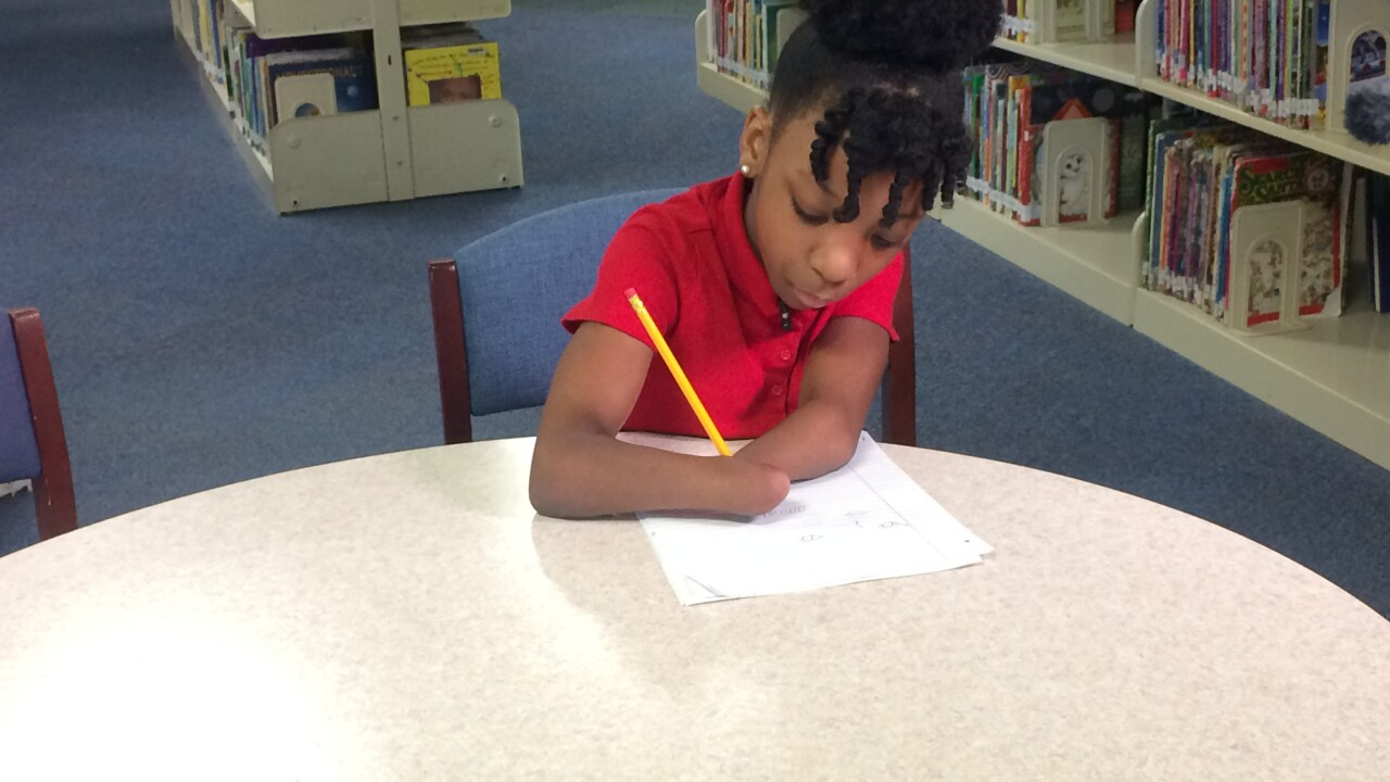 Chesapeake child born without hands uses penmanship to overcome challenges