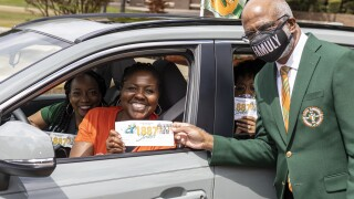 PC: FAMU President Larry Robinson, Ph.D., greets three donors who dropped off their 1887Strikes checks in front of Lee Hall Friday. (Vaughn Wilson)