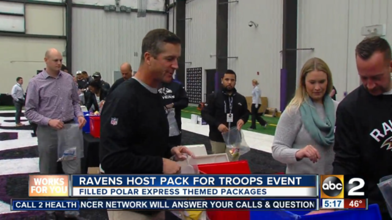 Ravens stuff holiday care packages for military youth