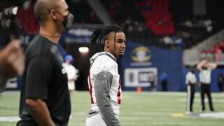 Alabama Crimson Tide receiver Jaylen Waddle watches from sideline during 2020 SEC Championship