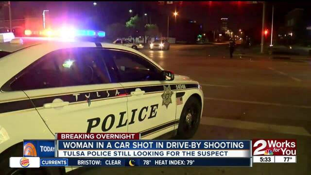 Woman shot in car during drive-by shooting