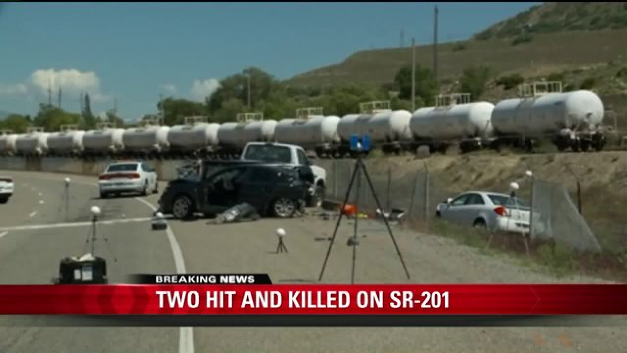 Brothers killed after car hits vehicles parked alongside SR-201 near Magna