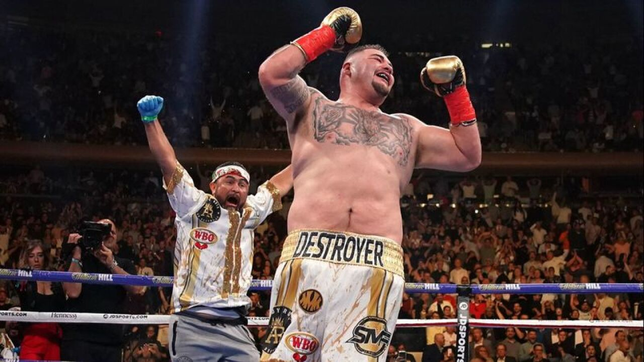 Andy Ruiz Jr. celebrates as trainer Manny Robles runs into the ring to join him after his stunning victory over previously unbeaten three-belt heavyweight champion Anthony Joshua on June 1. (Timothy A. Clary / AFP/Getty Images)