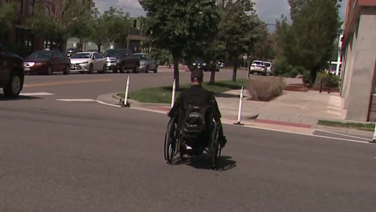Man in wheelchair struck by car, gets ticket for not crossing road fast enough