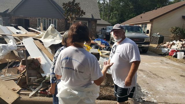 PHOTOS: Local Flood Victim Helps Restore Home In Houston