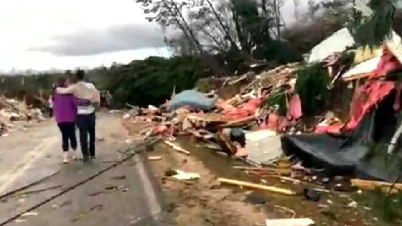 More than a dozen people killed in tornadoes in Alabama and Georgia