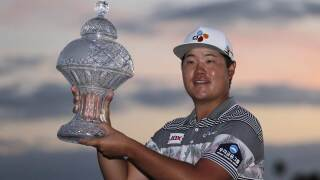 Sungjae Im of South Korea holds the trophy after winning the Honda Classic golf tournament, Sunday, March 1, 2020, in Palm Beach Gardens, Fla.