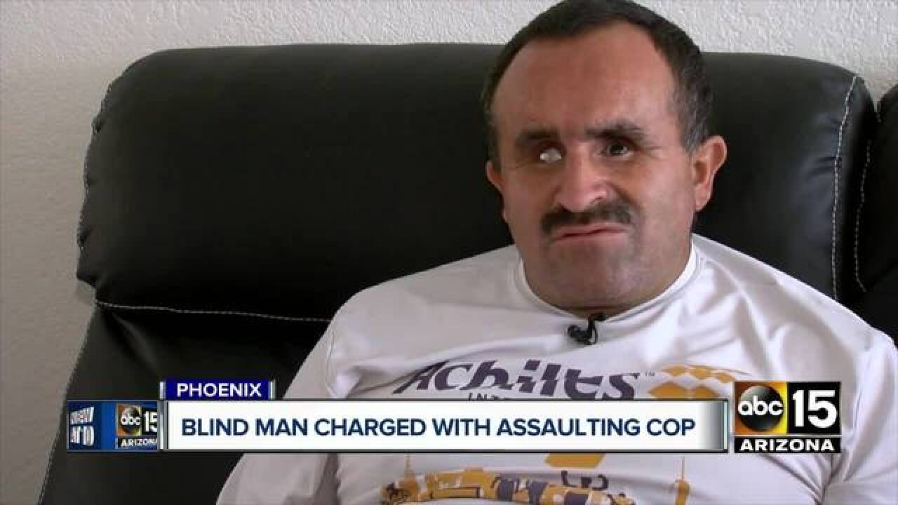 Blind man fighting arrest for assault on officer