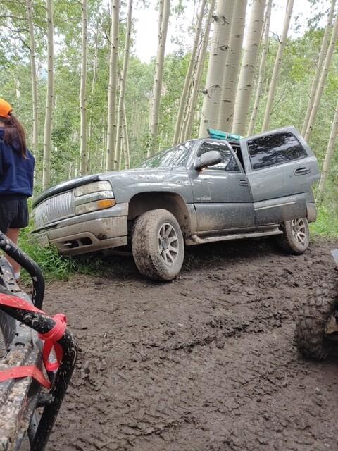 SUV slides off road