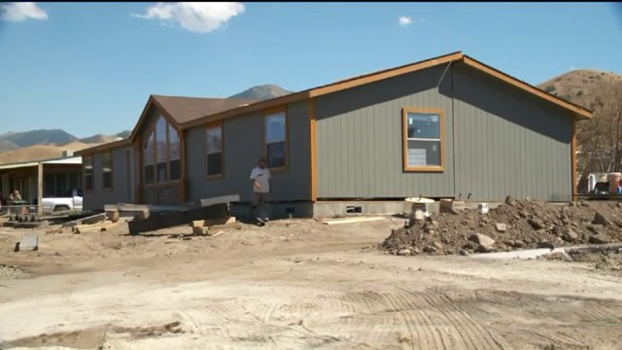 Family rebuilds after fire that destroyed several homes in Tooele