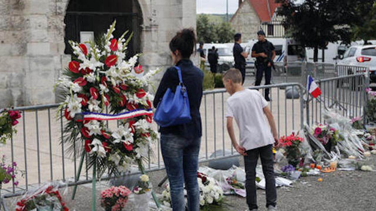 French ID second church attacker; warning 4 days earlier