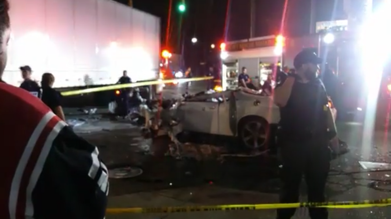 2 dead after car crashes into semi truck in Detroit