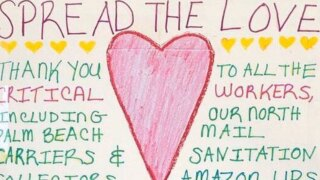 'Spread the Love' poster in North Palm Beach