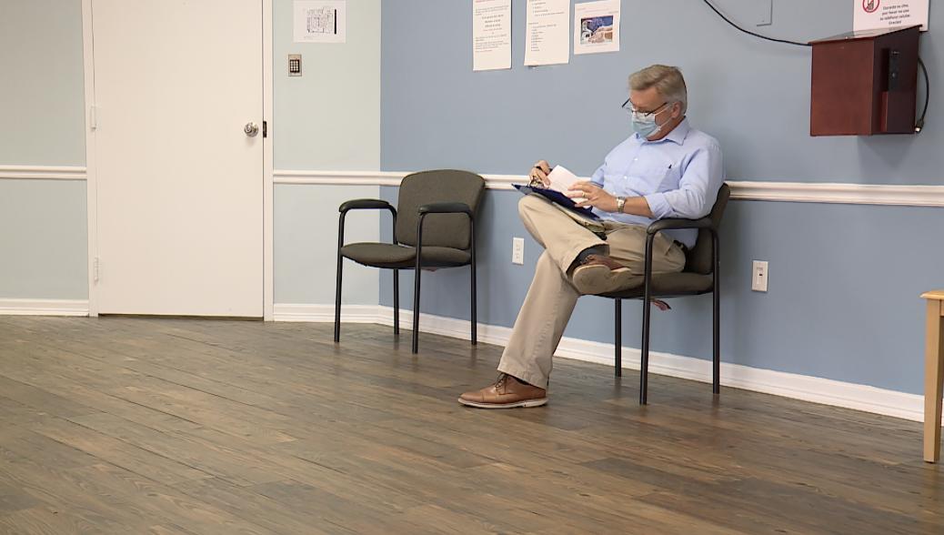 Matt Sczesny fills out paperwork prior to undergoing COVID-19 vaccine trial
