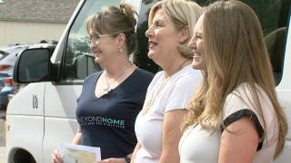 Leaders at BeyondHome receiving Contact Denver7 Gives check for $4,000