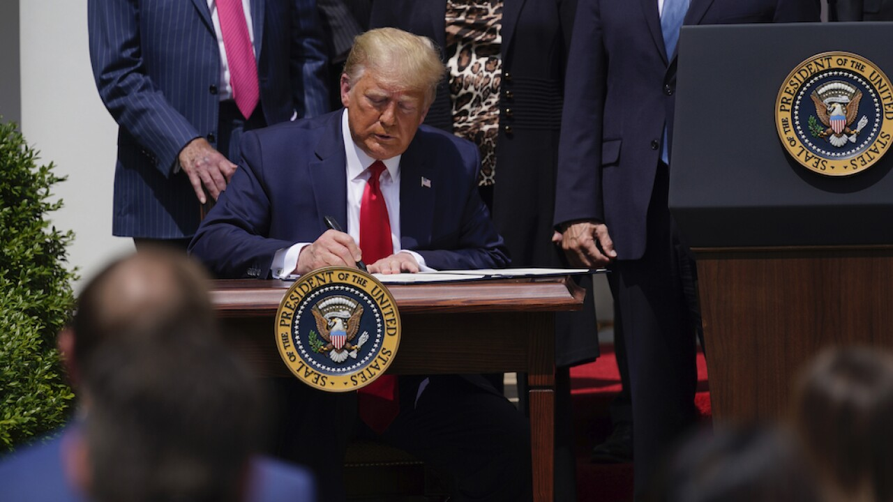 President Donald Trump signs new law that extends PPP, relaxes regulations