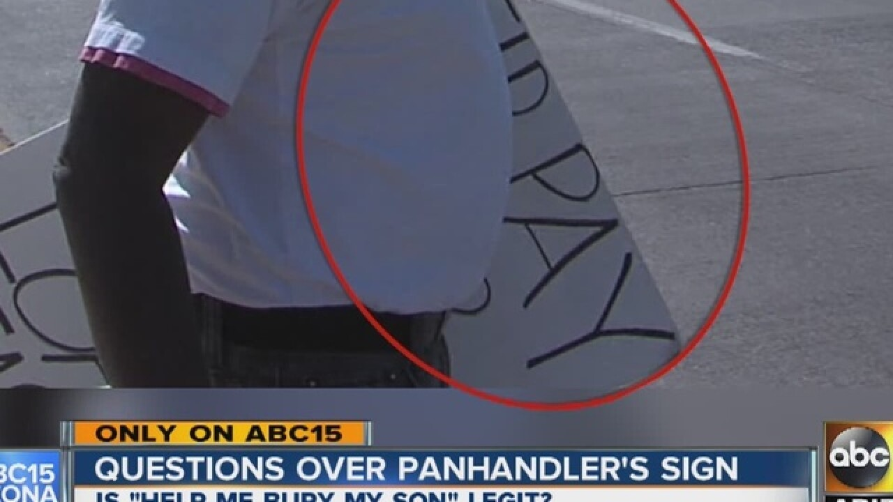 City wonders if panhandler's sad sign is truth