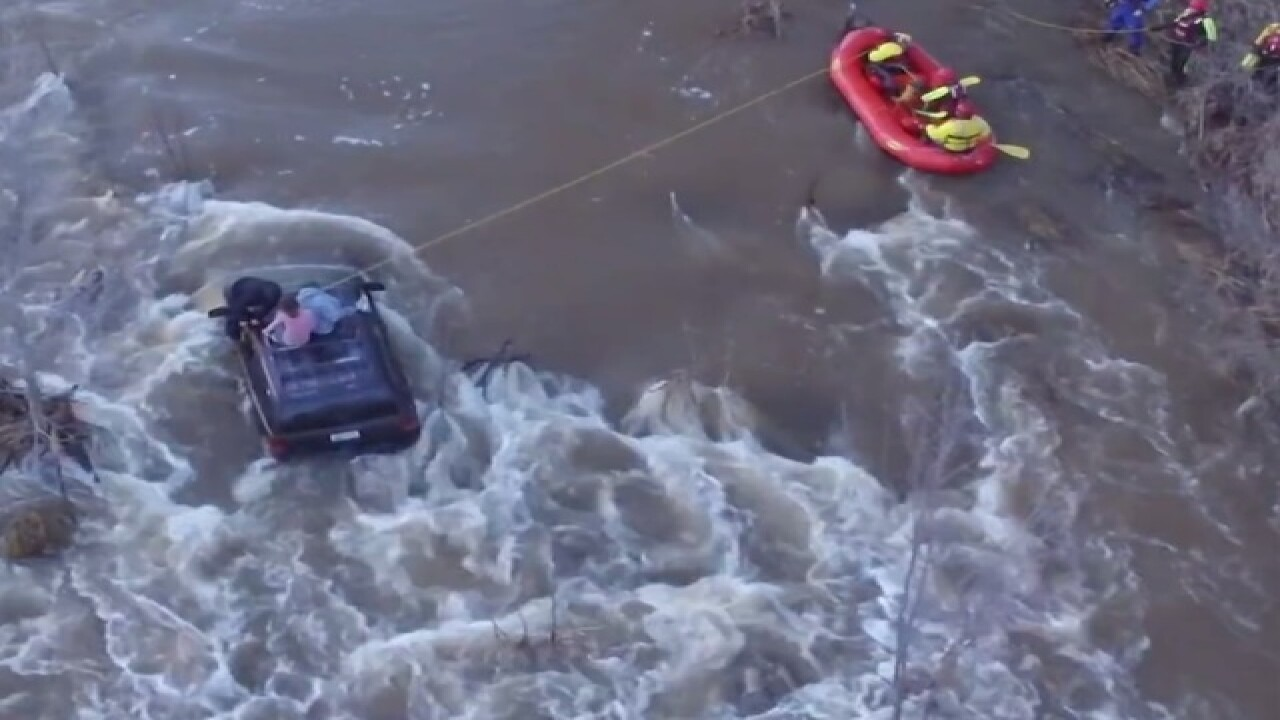 VIDEO: Firefighters rescue 3 from top of SUV trapped in Beaver Creek