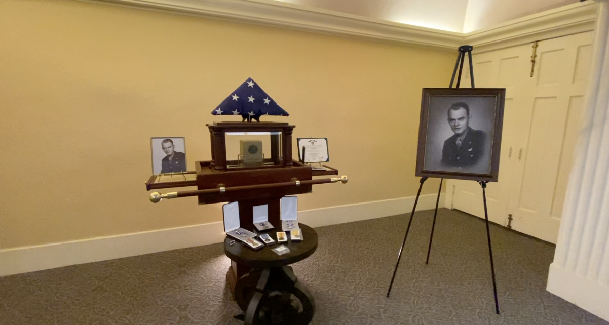 Pictures, flag, and urn with Lt. Parker's remains