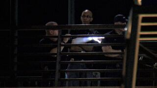 Police investigate after Englewood officer is shot in exchange of gunfire with domestic violence suspect on a light-rail platform.