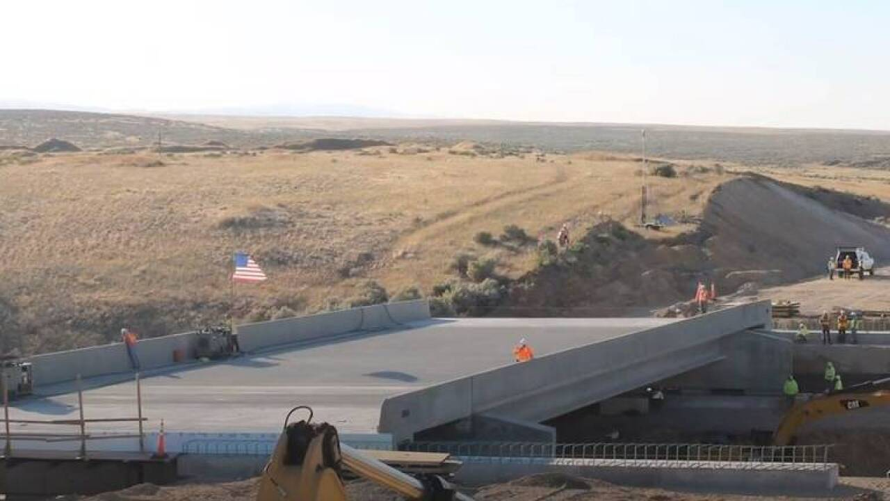 Blacks Creek Bridge eastbound lane being moved into place on I-84 in July 2020 snip from ITD video widescreen crop.jpg