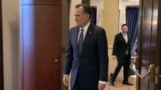Mitt Romney leaves meeting with Senate leaders