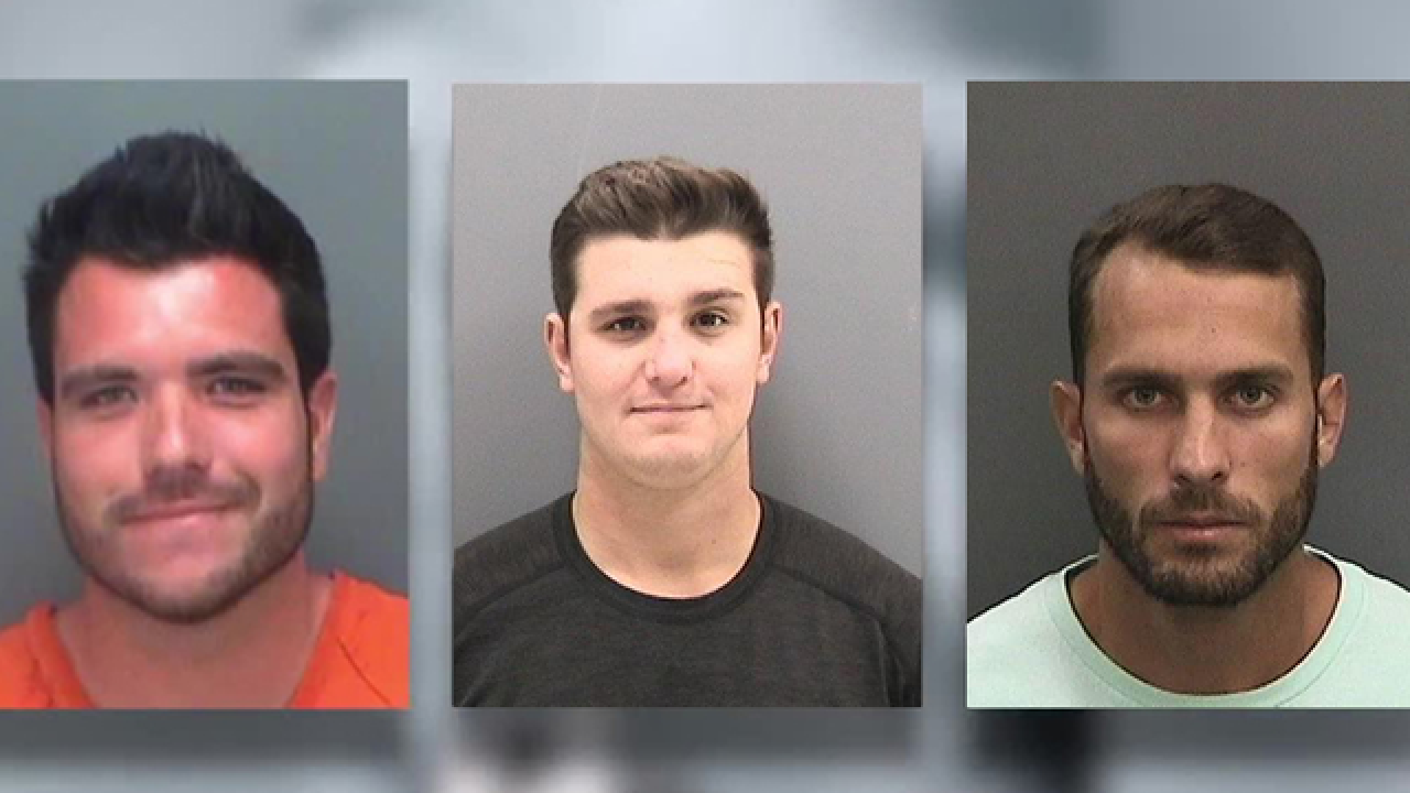 FWC charges 3 men in viral shark dragging video