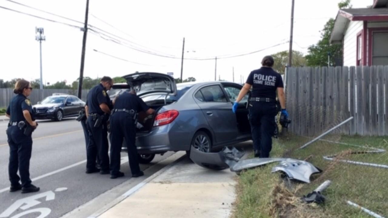 Car crashes into fences.JPG