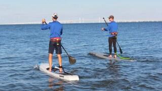 Chris Hopkinson (left) on the Chesapeake Bay (Courtesy: Facebook/ @BayPaddle)