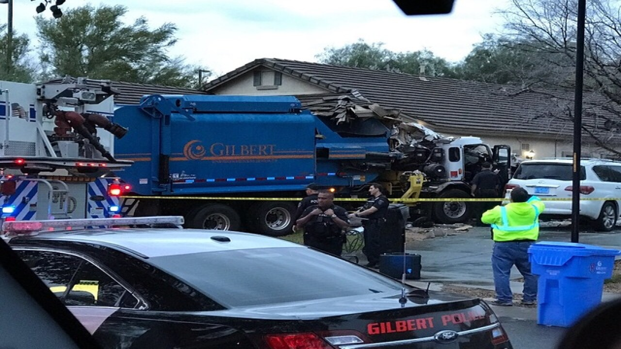 Garbage truck crashes into Gilbert house