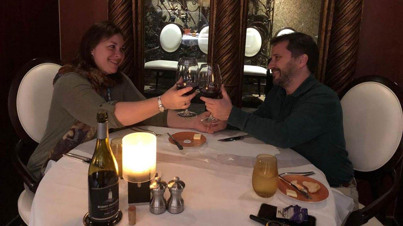 Laura Gabaroni and Juan Huergo cheers on cruise ship
