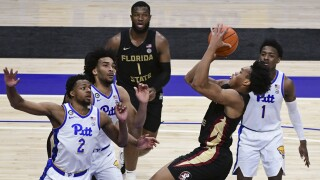 Florida State Seminoles guard Scottie Barnes shoots over Pittsburgh Panthers guard Femi Odukale, Feb. 20, 2021