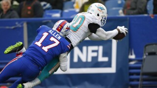 Josh Allen makes a tackle after an interception against the Dolphins