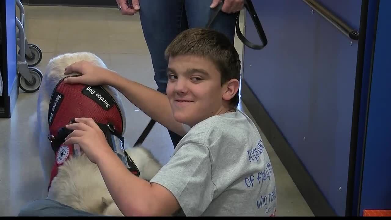 Community generosity continues for Lolo boy and his service dog