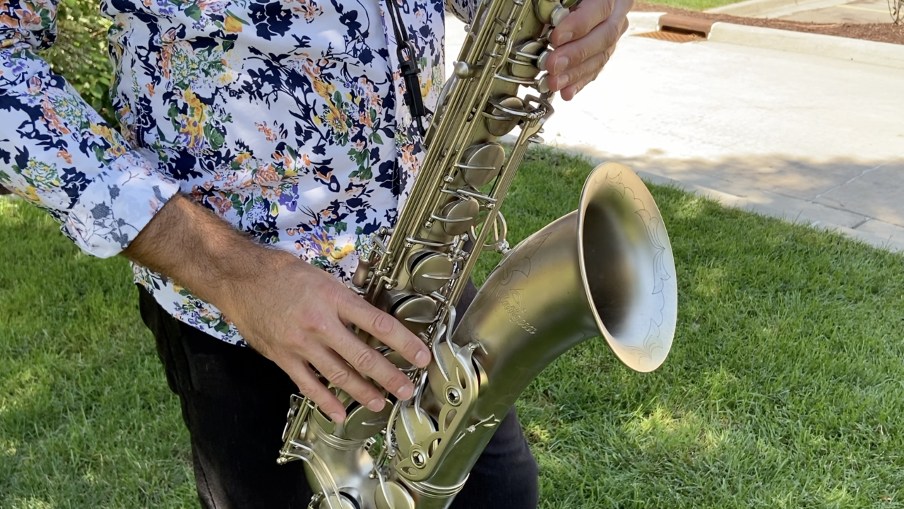 Close up of Phil Denny playing the saxophone