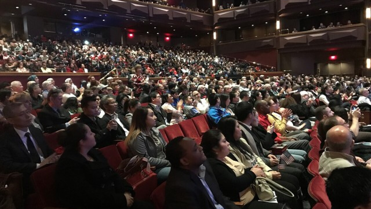 Hundreds naturalized in naturalization ceremony