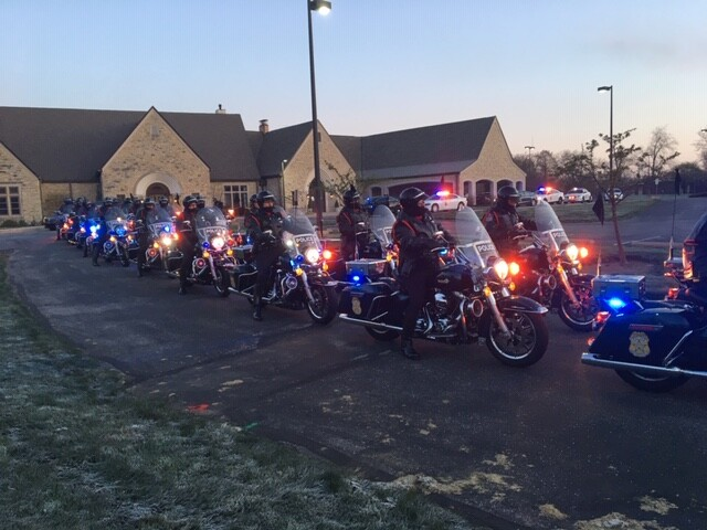 Officer Leath Funeral Procession Motorcycles at Funeral Home.JPG