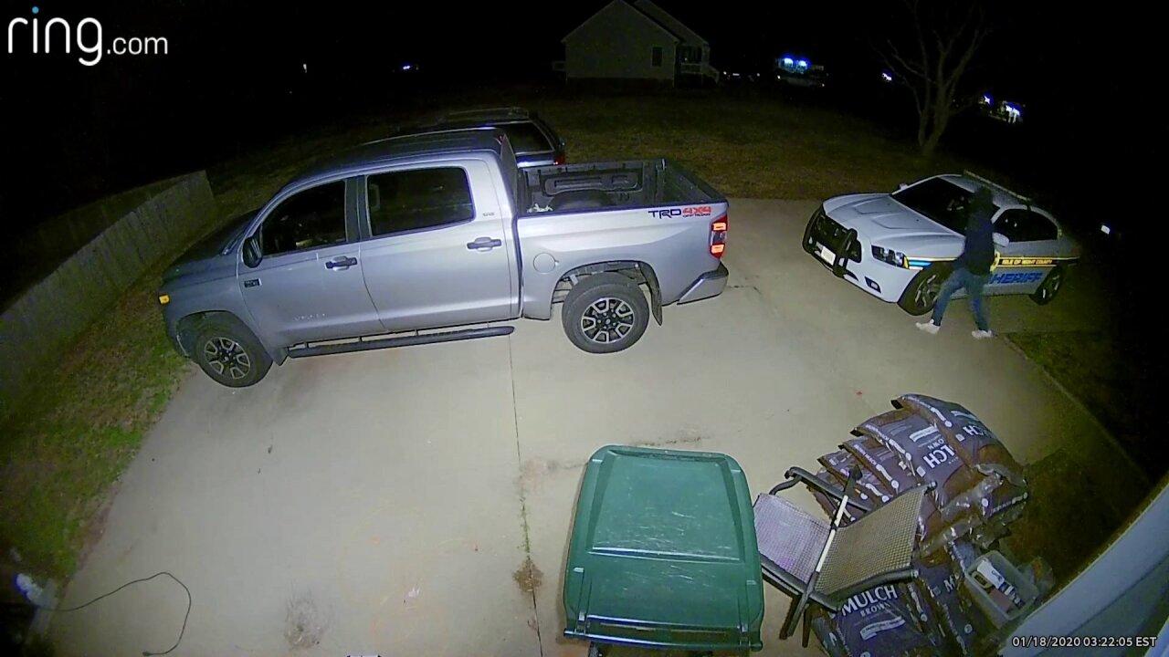 Breaking in to deputy's car.jpeg