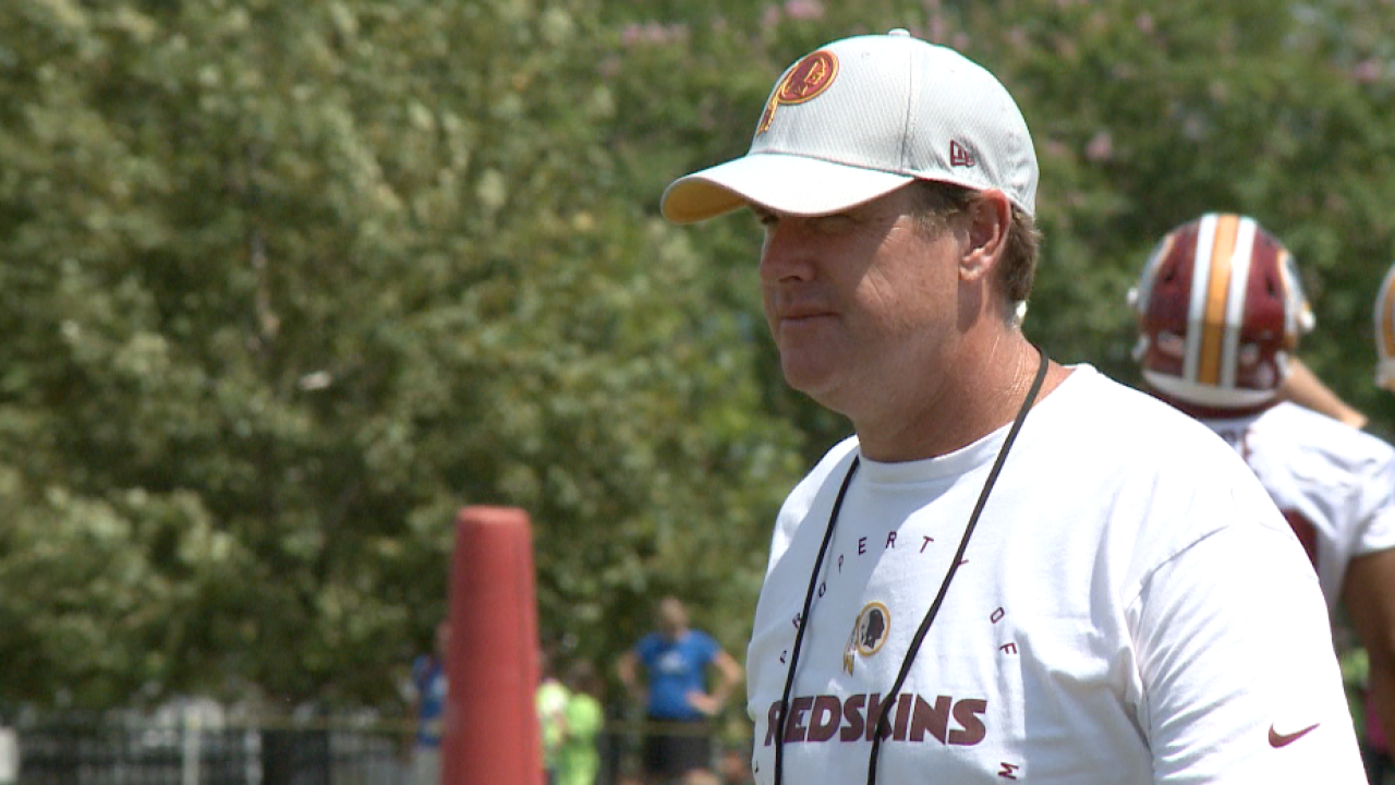 Jay Gruden is present, tense at training camp-opening press conference