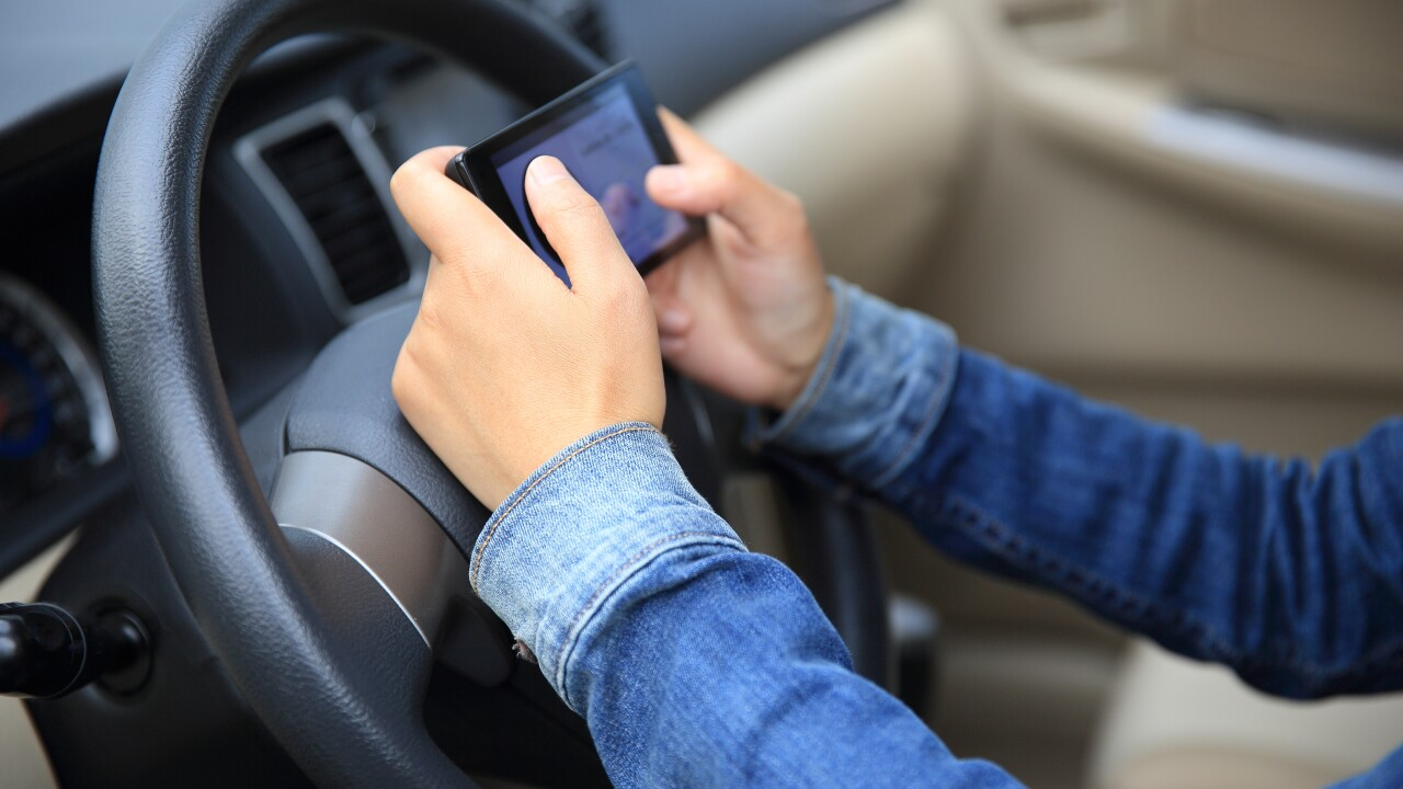 Parents aren't practicing what they preach by texting while driving, studyfinds