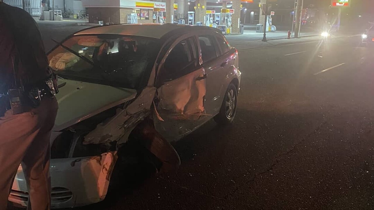 A photo of a damaged vehicle in from the wrong way crash in Midvale posted to social media by Utah Highway Patrol.
